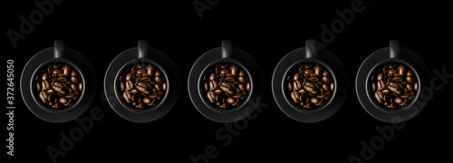 Fotografie, Obraz Five black cups with coffee beans and saucers on black background