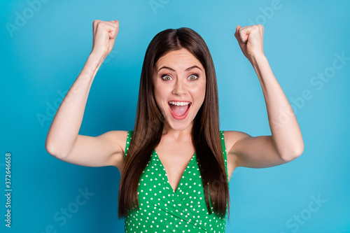 Photo of attractive excited lady yelling overjoyed raise fists successful person Canvas Print