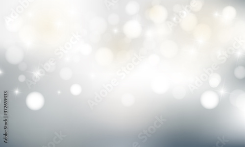 Fotografía Christmas background with blur golden lights with snowflakes.