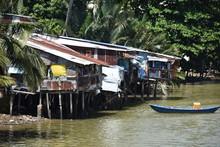 Riverside Shanties And Rowboat...