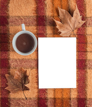 Old Checkered Blanket With Orange Red And Brown Patterns. Dry Leafs. Cup Of Coffee.autumn Background