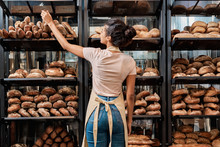 Young Adult Woman Standing Near Fresh Baked Bread