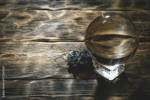 Obraz Crystal ball on the magic table background. Future reading. - fototapety do salonu