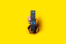 Female Hand Holding A TV Remot...