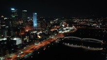 Downtown Pittsburgh Illuminated City Skyline PPG Building At Night Aerial With Water Reflection 4K