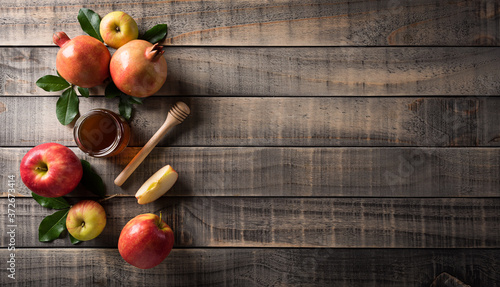 Rosh hashanah (Jewish New Year holiday), Concept of traditional or religion symbols on dark wooden background Fototapete