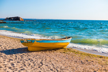 Beautiful Seascape View With An Old Boat On The Blue Sea Tropical Beach In Sunny Day