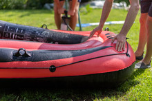 Red Rubber Boat Is Inflated Wi...