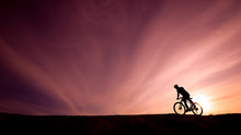 Silhouette Of A Cyclist On A S...