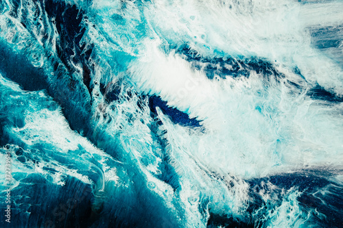 Alcohol ink water. Sea storm. Blue ocean wave splash with white foam effect. Marble texture creative design. Nature art background. Mineral stone abstract pattern with fleck grain.