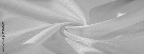 Fototapeta Texture, background, pattern, silk fabric of white color, solid light white silk satin fabric of the duchess Really beautiful silk fabric with satin sheen