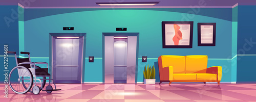 Photo Hospital corridor with open elevator doors, yellow sofa and wheelchair