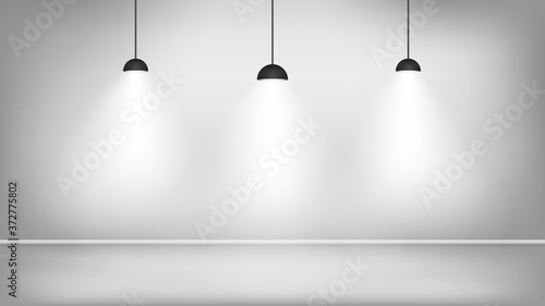 Fotografia Black lamps in white studio near the wall. Vector illustration