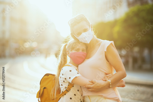 Fotografie, Tablou modern mother and school pupil embracing outside