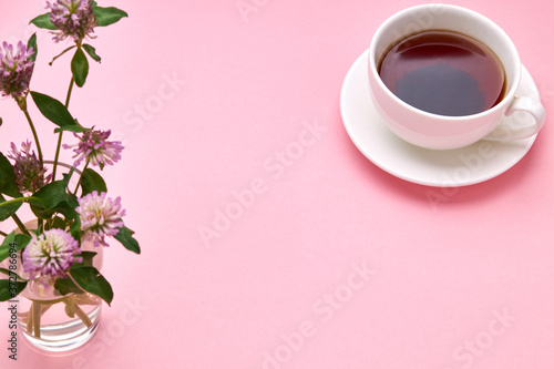 above view for a table with white tea cup and flowers on it Wallpaper Mural