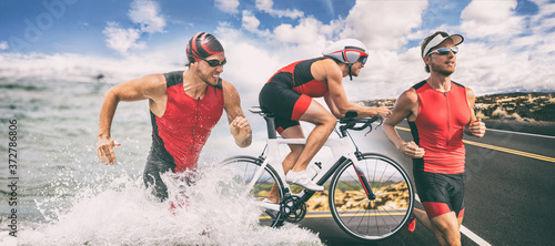 Obraz na plátně Triathlon swim bike run triathlete man running biking swimming in ocean at ironman race banner panorama