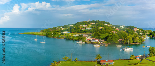 Valokuvatapetti A panorama view over Castries, St Lucia towards the airport in the morning