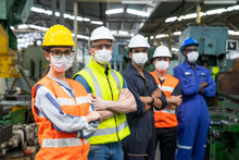Portrait Of Confident Engineer Woman. Diverse Multiethnic Worker Wearing Surgical Mask In Manufacturing Factory On Day Covid-19 Virus Pandemic. New Normal, Epidemic Prevention. Selective Focused