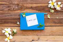 I Miss You Message Card Handwriting On Blue Diary Book With White Flowers Frangipani ,jasmine Arrangement  Flat Lay Style On Background Wooden