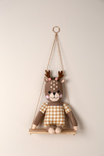 Shelf With Cute Toy Deer On Beige Wall. Child's Room Interior Element