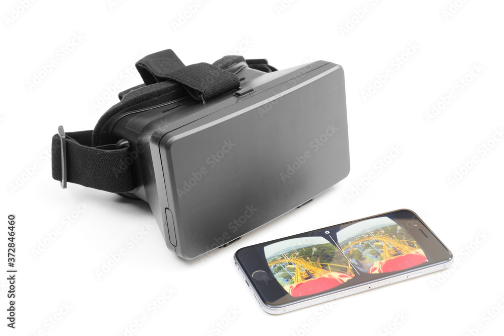 Melbourne, Australia - May 17, 2016: View of a VR headset and an iPhone playing VR video on YouTube. The newly updated YouTube app allows users to watch videos in VR with Google Cardboard