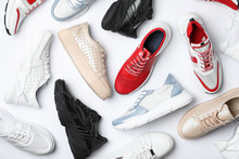 Many Stylish Sneakers On White Background, Top View