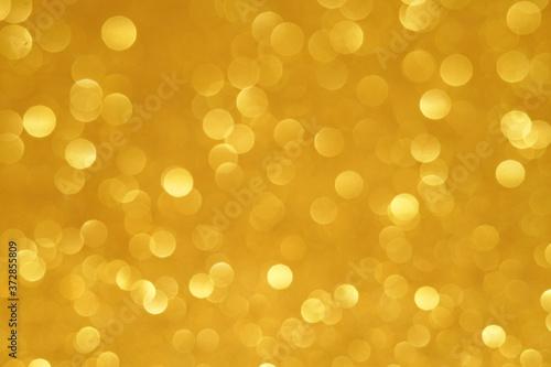 Vászonkép gold Sparkling Lights Festive background with texture
