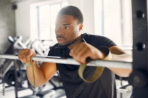 Sports man in the gym Canvas Print