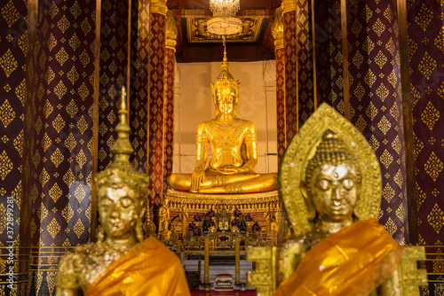 Ayutthaya, Thailand - June, 22, 2020 : Golden buddha image in ancient temple in Fotobehang