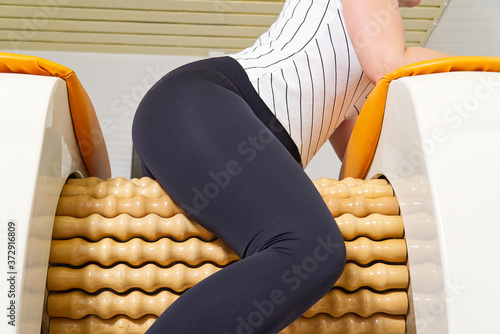 woman making massage for leg fits Fototapet