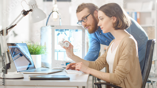 Shot of a Young Bearded Male Manager Helping to a Female Engineer Developer, who is using Laptop Computer and Expecting 3D Model Wallpaper Mural