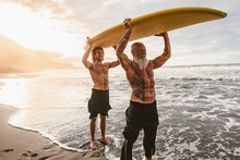 Happy Friends With Different Age Surfing Together On Tropical Ocean - Sporty People Having Fun During Vacation Surf Day - Elderly And Youth People And Extreme Sport Lifestyle Concept