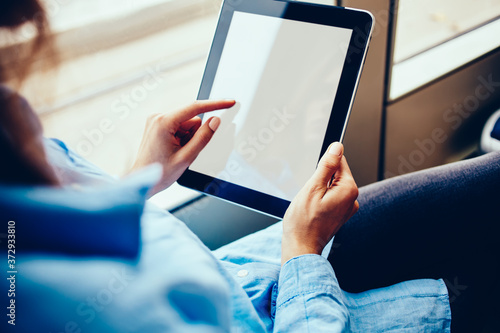 Cropped view of woman's hands holding modern touch pad device and touching on bl Slika na platnu