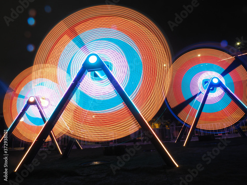 Low angle shot of illuminated circle decorations in a park