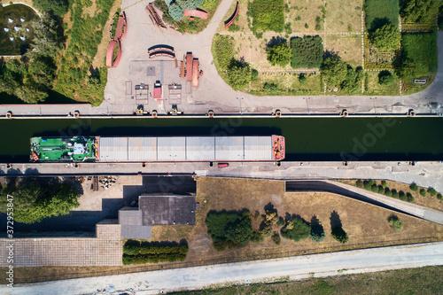 Leinwand Poster Ship is passing through Gatun Locks, part of Panama Canal.
