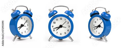 Photo Three blue alarm clock over white