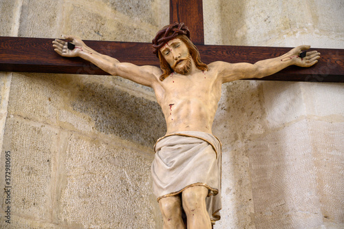 Sculpture of Jesus Christ on the cross Wallpaper Mural