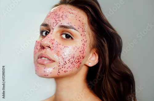 Charming woman with cosmetic mask on face Fototapet