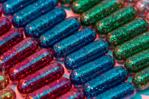Photographie Creative concept with many colorful glitter pills lying in rows diagonally