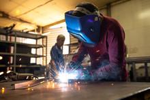 Welder Works On A Metal Surface