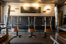 Chairs On Tables In Empty Cafe