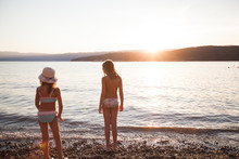 Children Have Fun On The Beach At Sunset