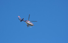 Austrian Federal Police Helicopter Flying, Blue Sky In The Background