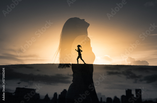 Woman dunning free in nature looking up to the sky. Freedom, and enlightenment concept. Double exposure
