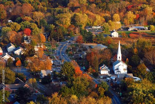 Fototapeta Autumn foliage surrounds a quaint New England town