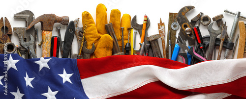 Patriotic collection of worn and used work tools with US American flag Wallpaper Mural