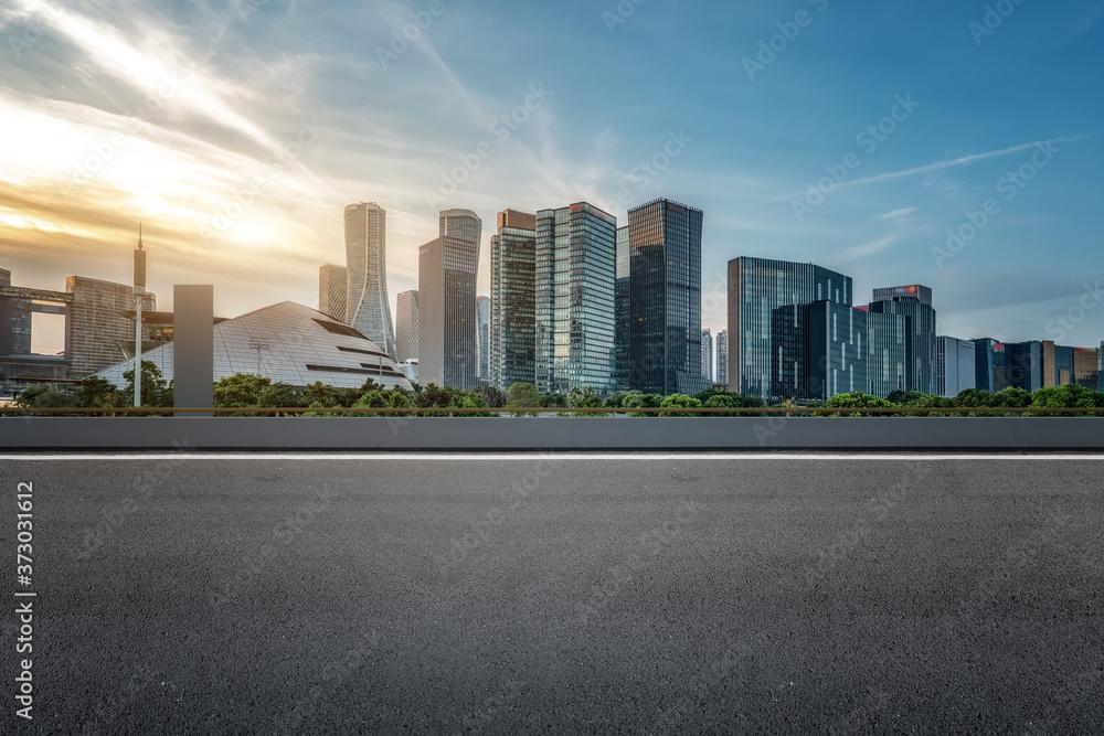 Fototapeta Empty asphalt road along modern commercial buildings in China, s cities