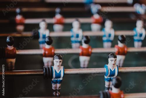 Obraz Selective shot of an aged foosball football player figures - fototapety do salonu