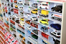 Diecast Model Cars Are Displayed For Sale On A Shelf In A Toy Store
