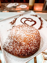 Vertical Shot Of Sufganiyah Bread On A Plate